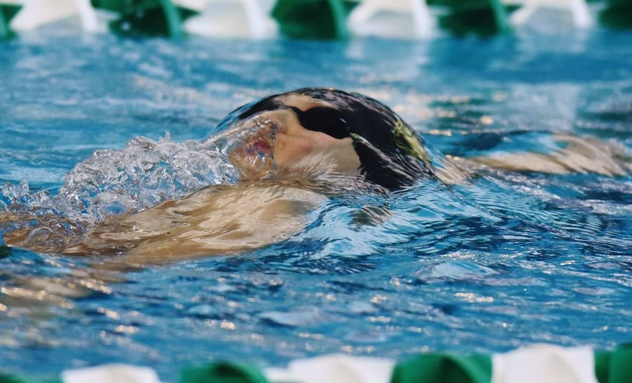 Stevenson's Daniel Ng begins to surface while swimming backstroke in the 200-yard individual medley during the Lake County Invitational at Stevenson on Saturday.