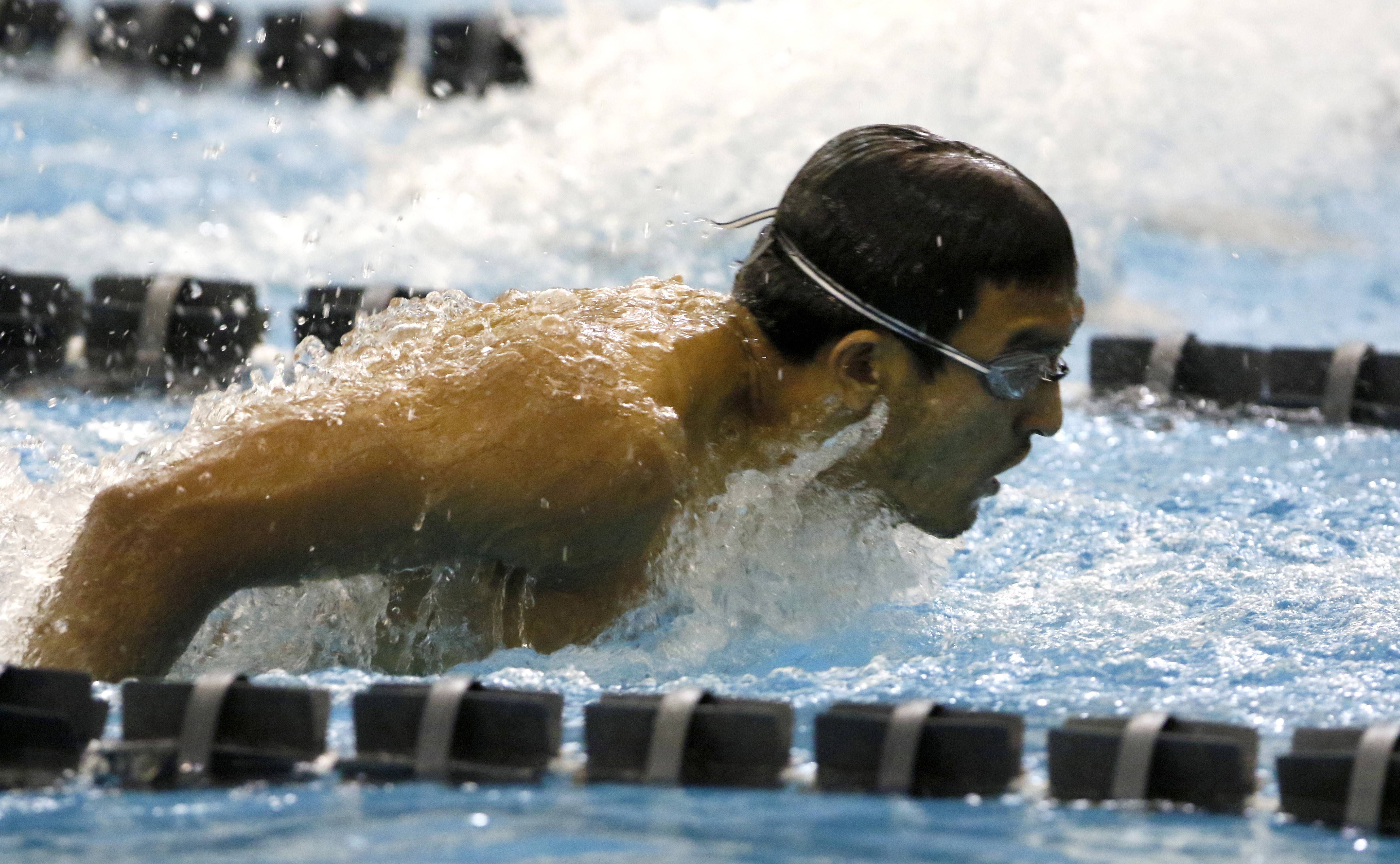 Neuqua Valley's Sathya Subramanian swims the 100-yard butterfly during the 17th annual Neuqua Valley Boys Swimming Invite.