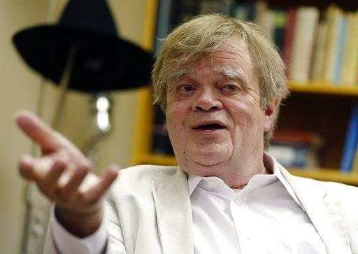 "FILE - In this July 20, 2015, file photo, Garrison Keillor, creator and host of ""A Prairie Home Companion,"" appears during an interview in St. Paul, Minn. ""A Prairie Home Companion"" has been given a new name - ""Live from Here"" - in the wake of Keillor's acrimonious split with Minnesota Public Radio. Chris Thile, the mandolin virtuoso who has hosted the weekly variety show since Keillor's retirement announced the new name Saturday, Dec. 16, 2017, as the show opened a live performance in New York City. (AP Photo/Jim Mone, File)"
