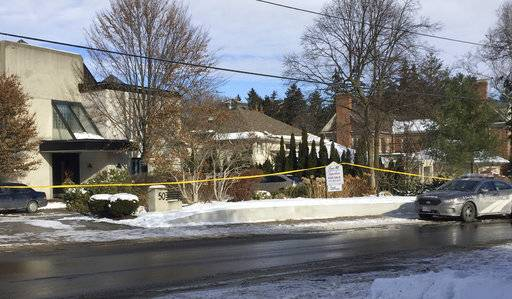 Police tape surrounds the home of billionaire Barry Sherman on Saturday, Dec. 17 2017, in Toronto. Sherman and his wife were found dead in the north Toronto mansion on Friday, Dec. 16. Police are investigating the deaths as suspicious. (AP Photo/Robert Gillies)
