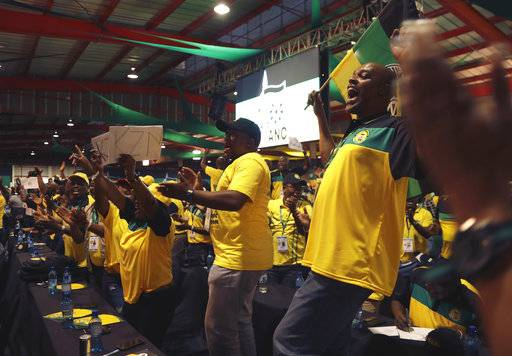 Delegates wait for the delayed start of the ruling African National Congress (ANC) elective conference in Johannesburg, Saturday, Dec. 16 2017. The fight to replace South Africa's scandal-prone President Jacob Zuma began Saturday as thousands of delegates of the ruling African National Congress gathered to elect a new leader. (AP Photo/Themba Hadebe)