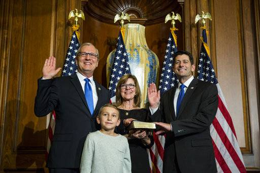 FILE - In this Jan. 3, 2017, file photo, House Speaker Paul Ryan of Wis. administers the House oath of office to Rep. Kevin Cramer, R-N.D., during a mock swearing in ceremony on Capitol Hill in Washington. In North Dakota, where Donald Trump won in a landslide last year, Republicans' lone Senate candidate, Cramer, is a little-known state lawmaker, and a potato farmer, from a remote small town closer to the Canadian border than the state capital Bismarck. While established Republicans and business leaders in other states Trump carried are running to topple Democratic senators, the GOP is struggling to land a big name in North Dakota.(AP Photo/Zach Gibson, File)