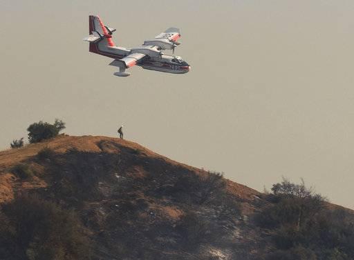Flames threaten rich California enclave, residents flee