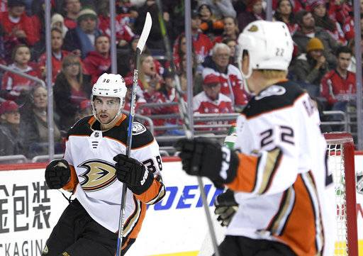Anaheim Ducks center Derek Grant (38) celebrates his goal with center Dennis Rasmussen (22) during the first period of an NHL hockey game against the Washington Capitals, Saturday, Dec. 16, 2017, in Washington. (AP Photo/Nick Wass)