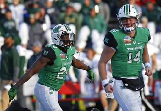 Marshall running back Keion Davis (24) celebrates with quarterback Chase Litton (14) after scoring a touchdown against Colorado State during the first half of the New Mexico Bowl NCAA college football game in Albuquerque, N.M., Saturday, Dec. 16, 2017. (AP Photo/Andres Leighton)