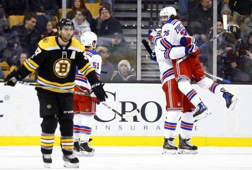 New York Rangers' Mats Zuccarello (36), of Norway, celebrates his goal with Chris Kreider, as Boston Bruins' Patrice Bergeron, left, skates away in overtime during an NHL hockey game in Boston, Saturday, Dec. 16, 2017. The Rangers won 3-2. (AP Photo/Michael Dwyer)