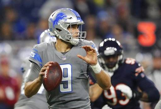 Detroit Lions quarterback Matthew Stafford looks downfield during the first half of an NFL football game against the Chicago Bears, Saturday, Dec. 16, 2017, in Detroit. (AP Photo/Paul Sancya)