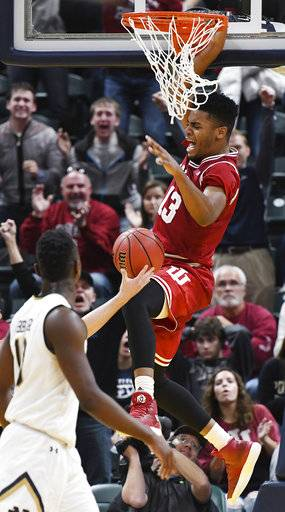 Indiana's Juwan Morgan (13) dunks over Notre Dame's Bonzie Colson (35) to give Indiana the lead in the final seconds of overtime during an NCAA college basketball game in Indianapolis, Saturday, Dec. 16, 2017. Indiana won 80-77 in overtime. (Chris Howell/The Herald-Times via AP)