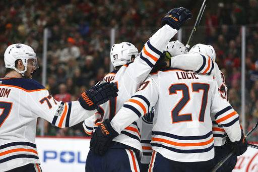 Edmonton Oilers' Milan Lucic (27) celebrates with teammates after scoring the team's second goal in the second period of an NHL hockey game against the Minnesota Wild, Saturday, Dec. 16, 2017, in St. Paul, Minn. (AP Photo/Stacy Bengs)