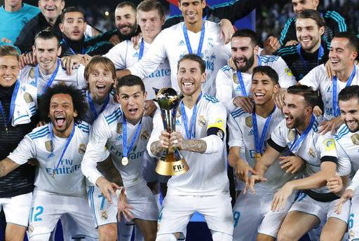 Real Madrid's Sergio Ramos holds the trophy after winning the Club World Cup final soccer match between Real Madrid and Gremio at Zayed Sports City stadium in Abu Dhabi, United Arab Emirates, Saturday, Dec. 16, 2017. (AP Photo/Hassan Ammar)