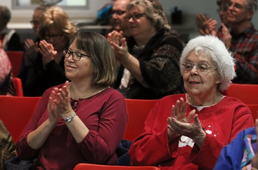 Theresa Pettineo and her mother, Elizabeth Bauer, of Bartlett, enjoy the Random Ringers holiday concert Sunday at the Poplar Creek Public Library in Streamwood.
