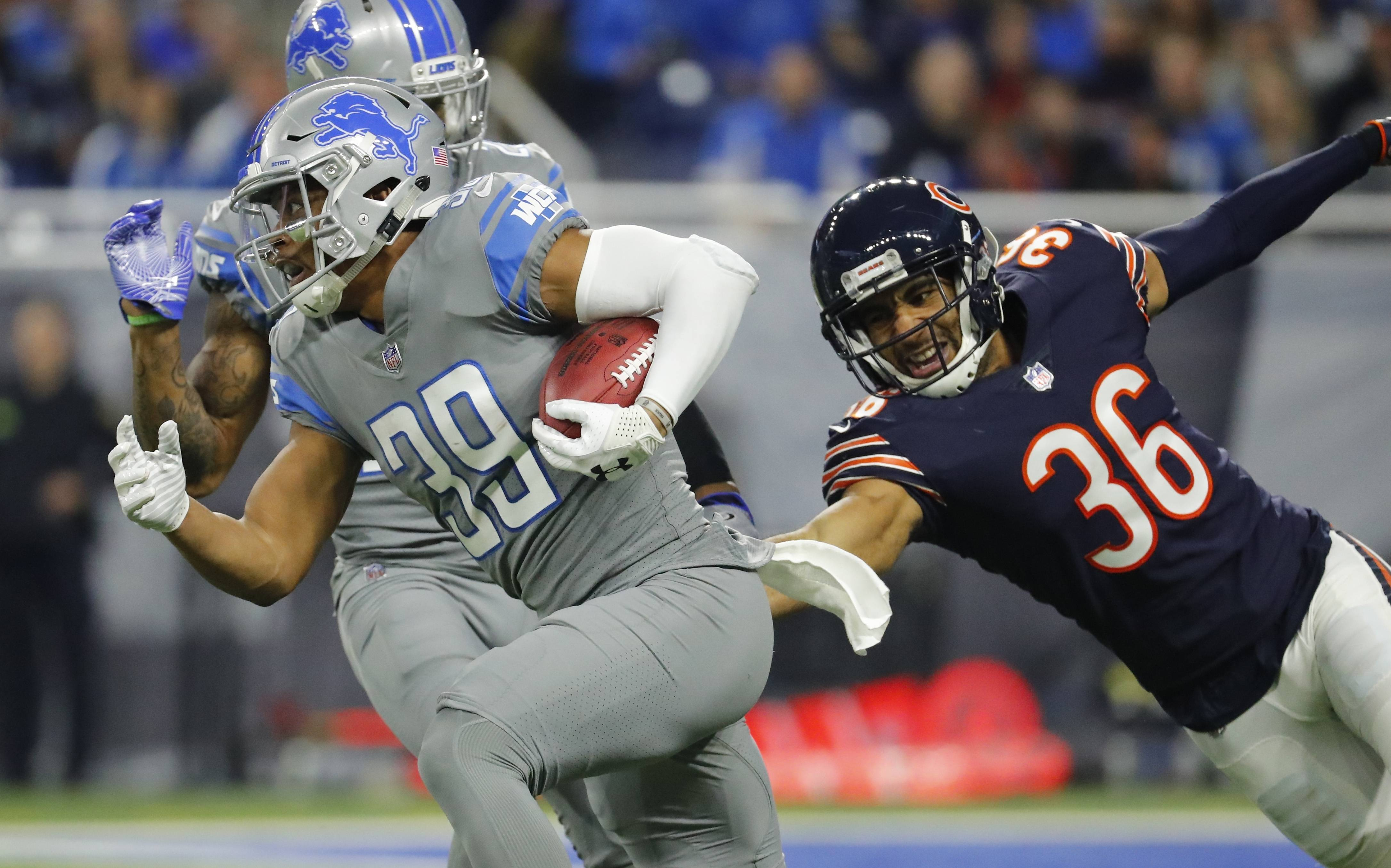 Chicago Bears free safety DeAndre Houston-Carson (36) attempts to reach Detroit Lions cornerback Jamal Agnew (39) during the first half of an NFL football game, Saturday, Dec. 16, 2017, in Detroit. (AP Photo/Rick Osentoski)