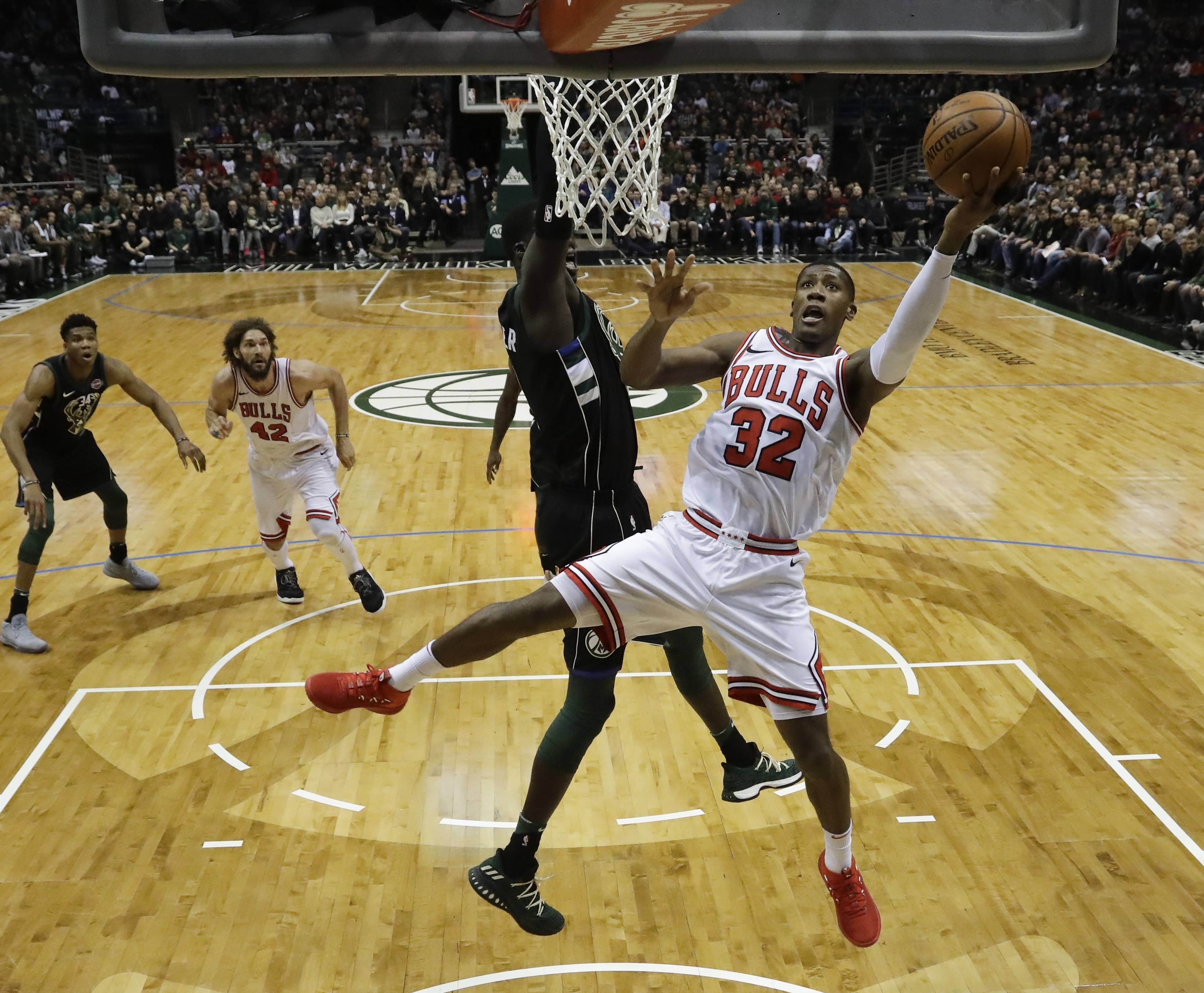 Chicago Bulls' Kris Dunn shoots during the first half of an NBA basketball game against the Milwaukee Bucks Friday, Dec. 15, 2017, in Milwaukee. (AP Photo/Morry Gash)