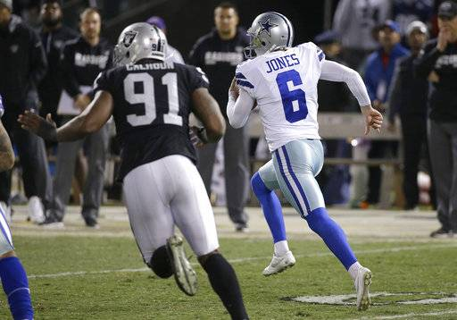 Dallas Cowboys punter Chris Jones (6) runs on a fake punt against the Oakland Raiders during the second half of an NFL football game in Oakland, Calif., Sunday, Dec. 17, 2017.