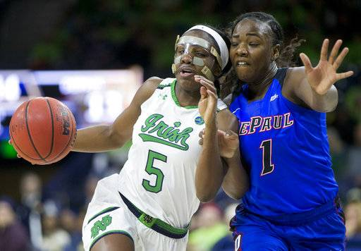 Notre Dame's Jackie Young (5) drives against pressure from DePaul's Ashton Millender (1) during the first half of an NCAA college basketball game Sunday, Dec. 17, 2017, in South Bend, Ind.