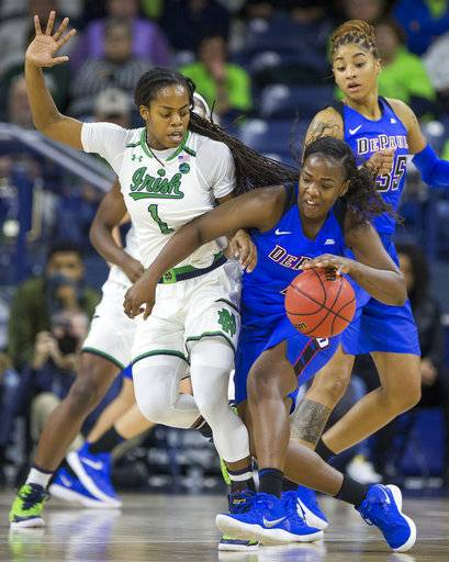 DePaul's Ashton Millender, right, runs into Notre Dame's Lili Thompson (1) during the first half of an NCAA college basketball game Sunday, Dec. 17, 2017, in South Bend, Ind.