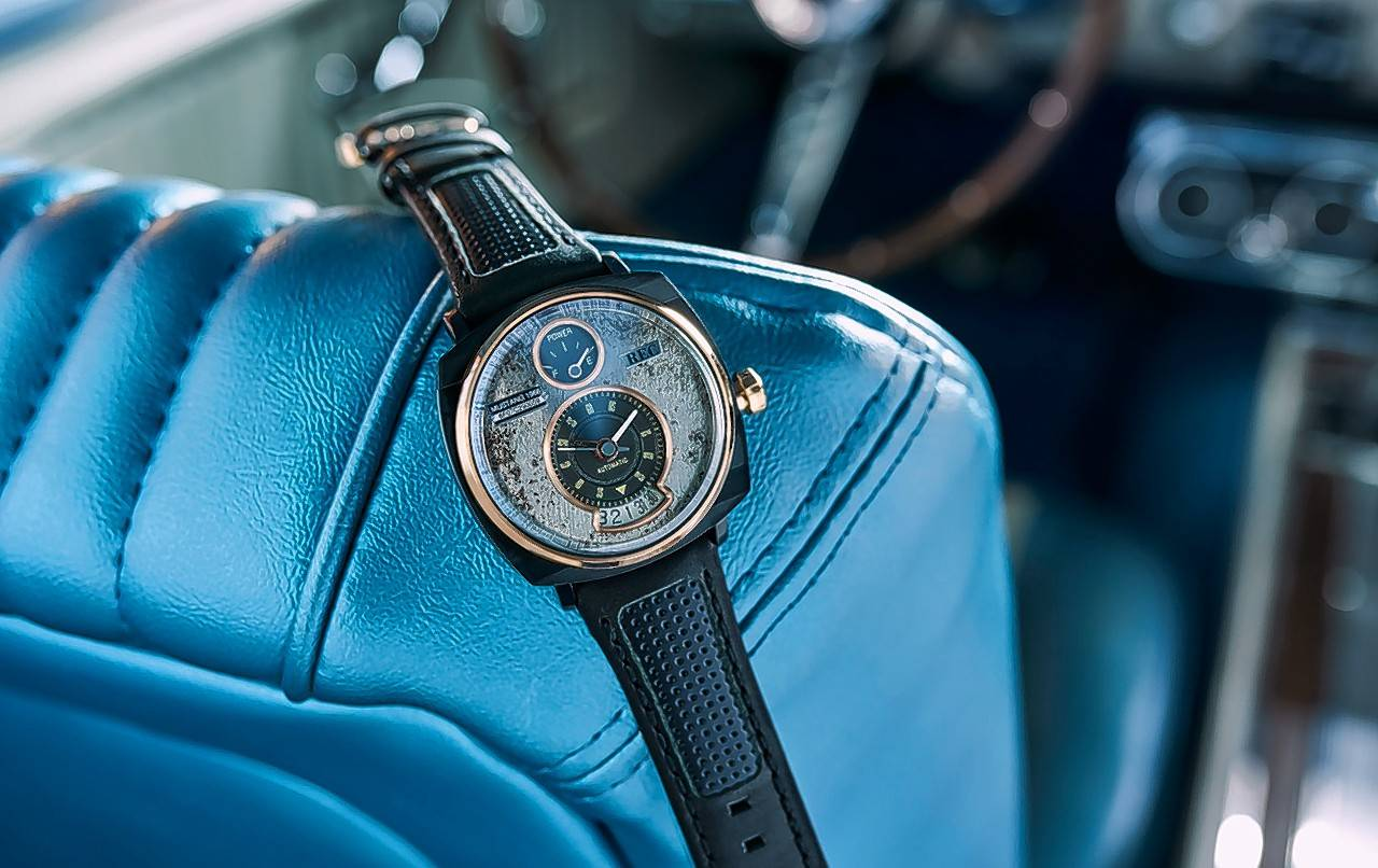 The hour hands mimic the look of a speedometer gauge.