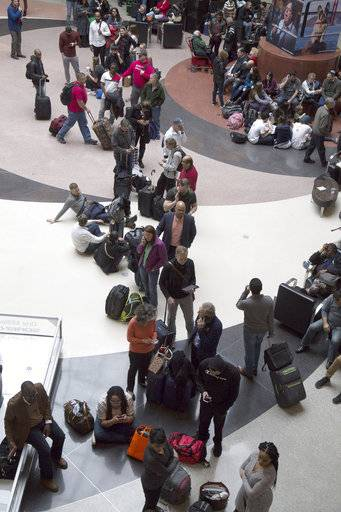 Long lines form at Hartsfield-Jackson International Airport after a power outage Sunday in Atlanta.