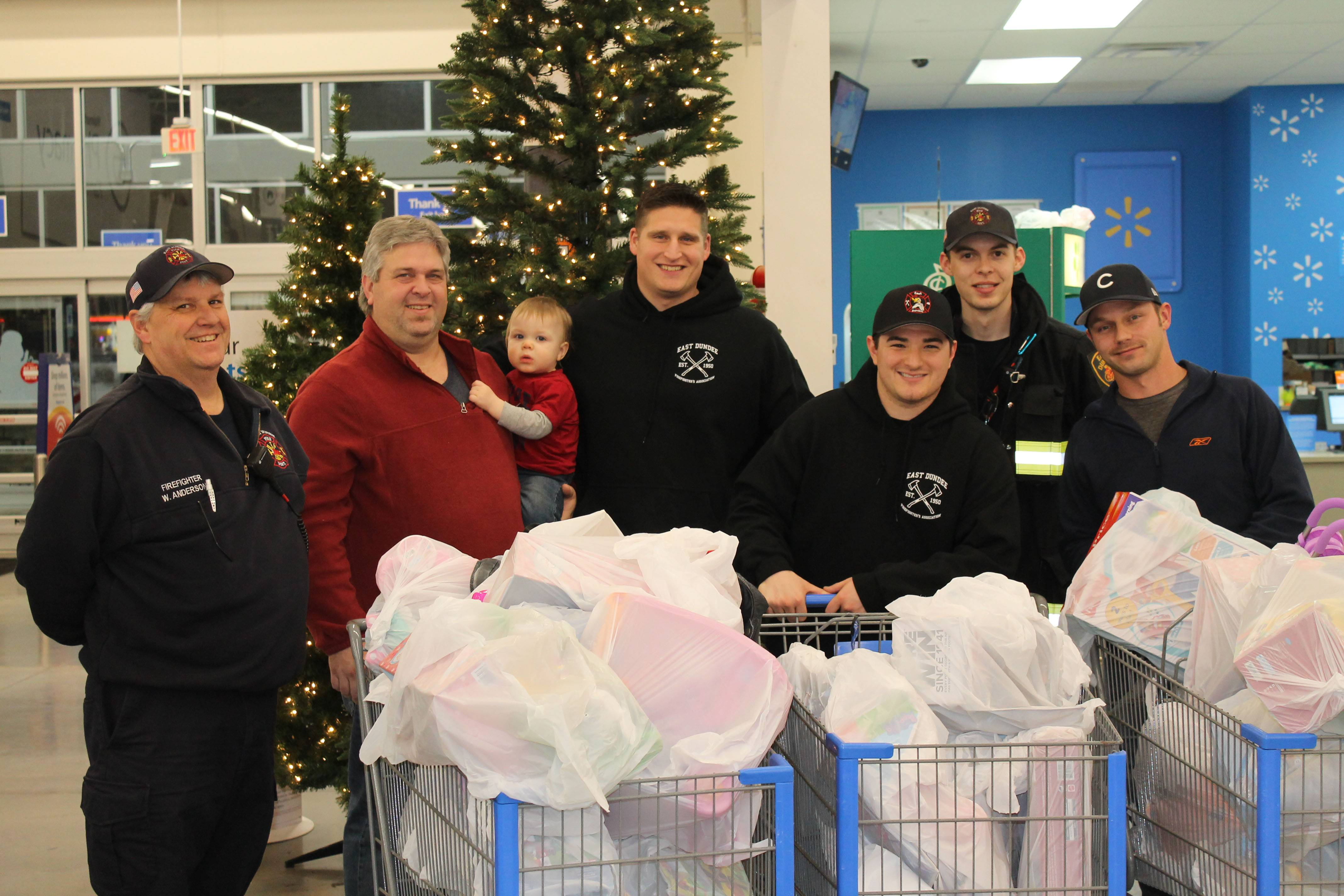 Members of the East Dundee Firefighters' Association continued their annual tradition of buying Christmas presents for Dundee Township children whose families cannot afford gifts. The toy drive is supported by the association's November meat raffle.
