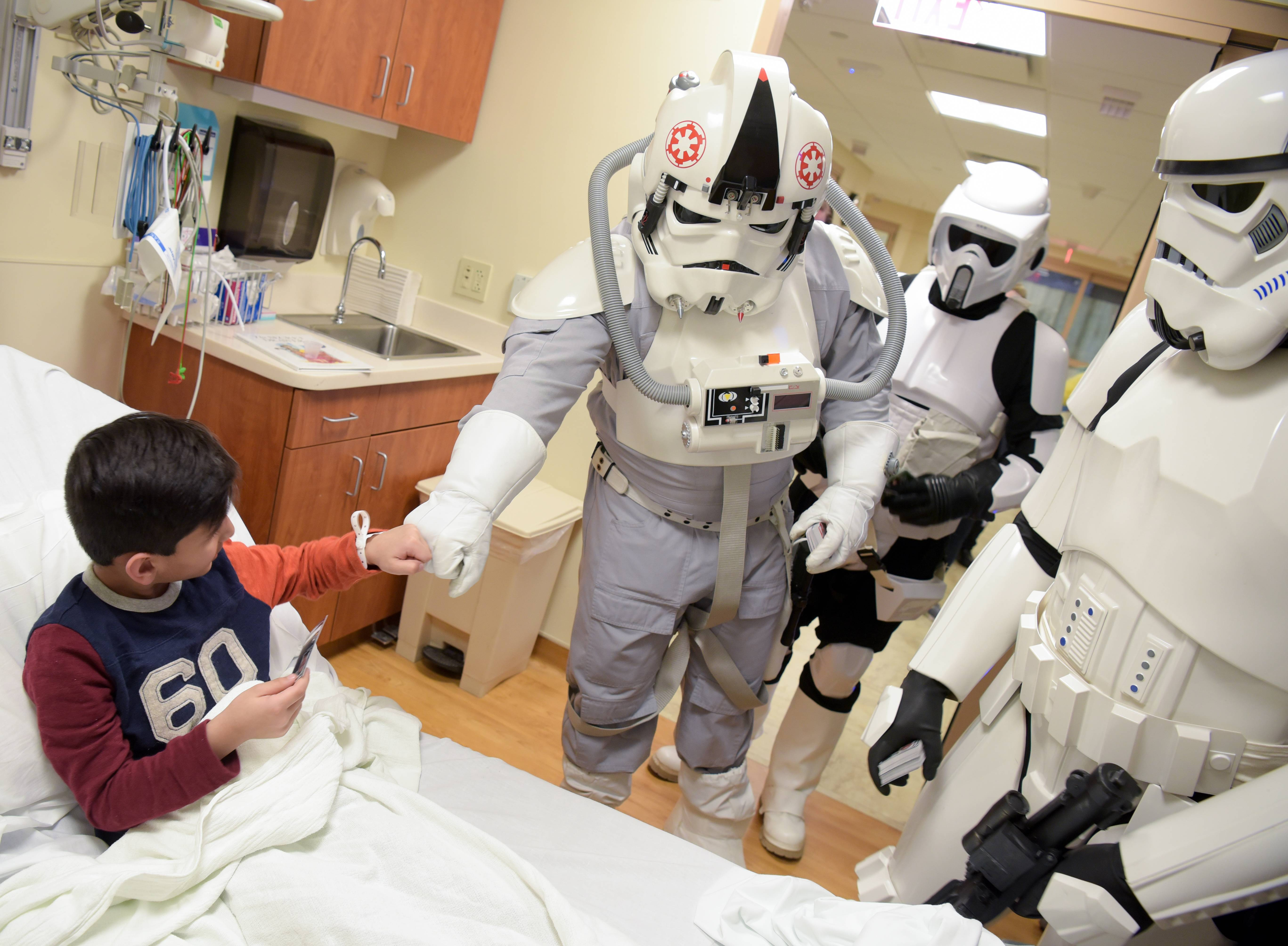 "Members of a ""Star Wars"" costuming club visit Noah Baig, a 5-year-old from Bloomingdale, in the pediatric emergency room Sunday at Northwestern Medicine Central DuPage Hospital in Winfield."