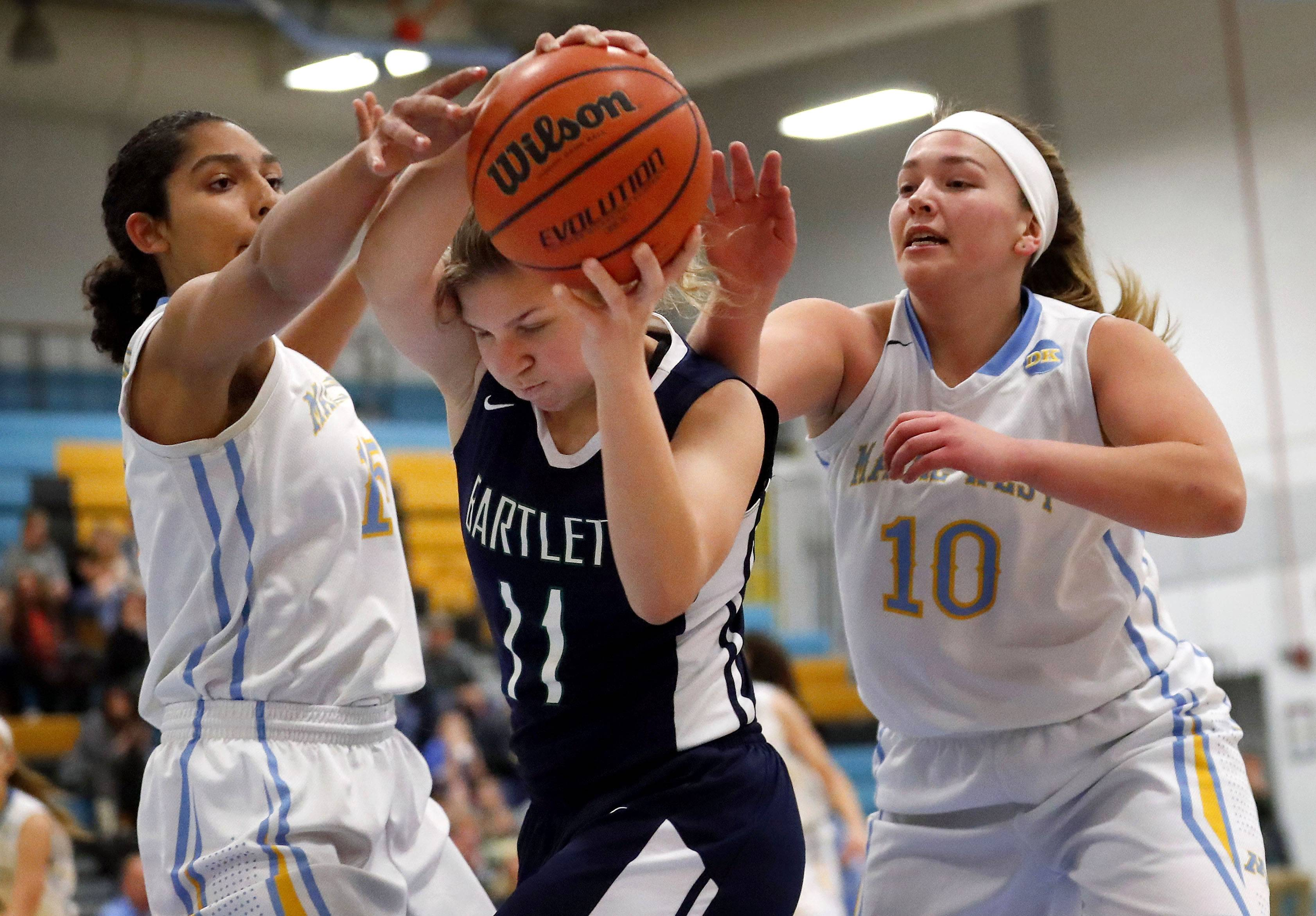 Maine West's Rachel Kent, left, and Allison Pearson defend against Bartlett's Alexis Sinclair.