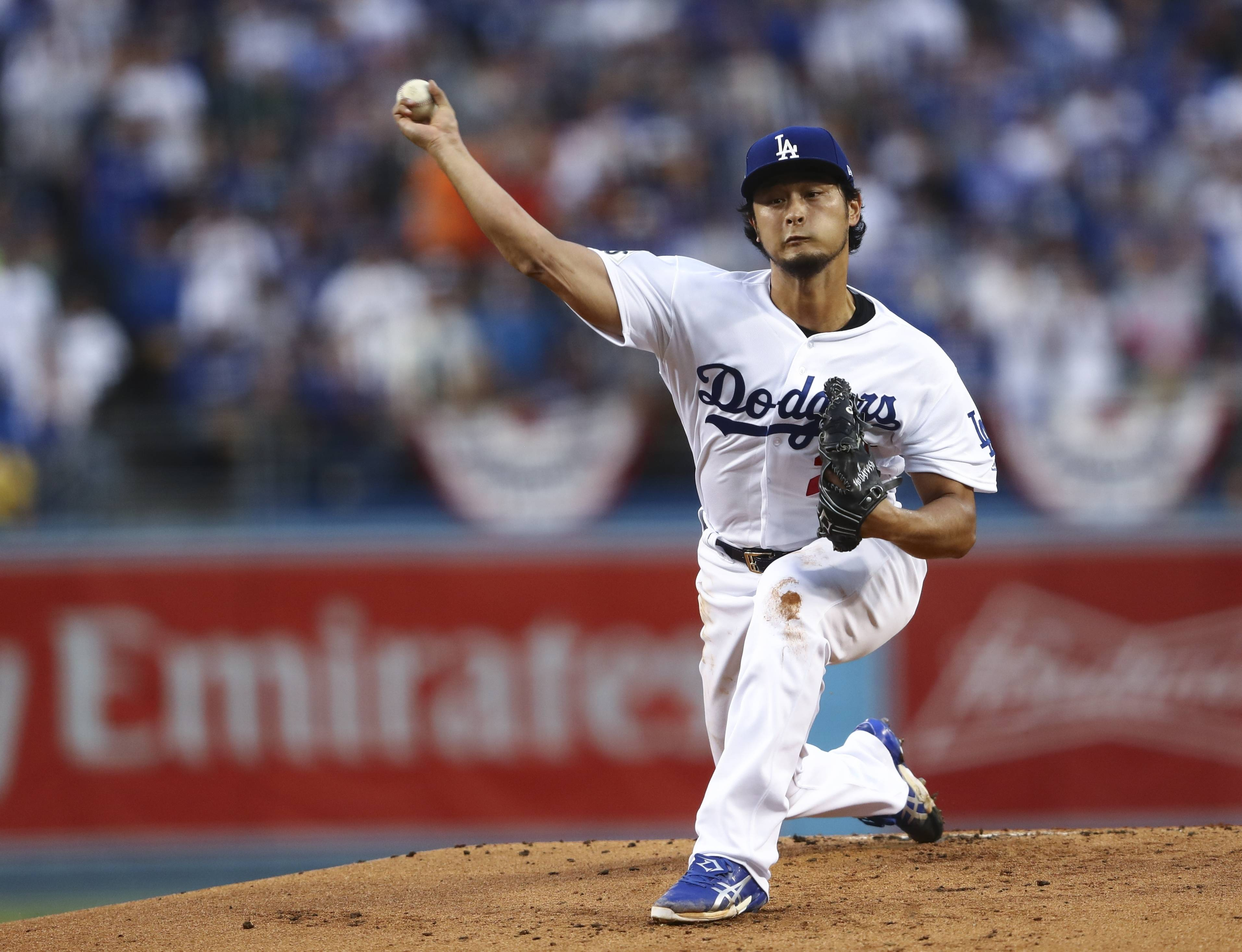 Los Angeles Dodgers starting pitcher Yu Darvish throws during the first inning of Game 7 of baseball's World Series against the Houston Astros Wednesday, Nov. 1, 2017, in Los Angeles. (AP Photo/Tim Bradbury, Pool)