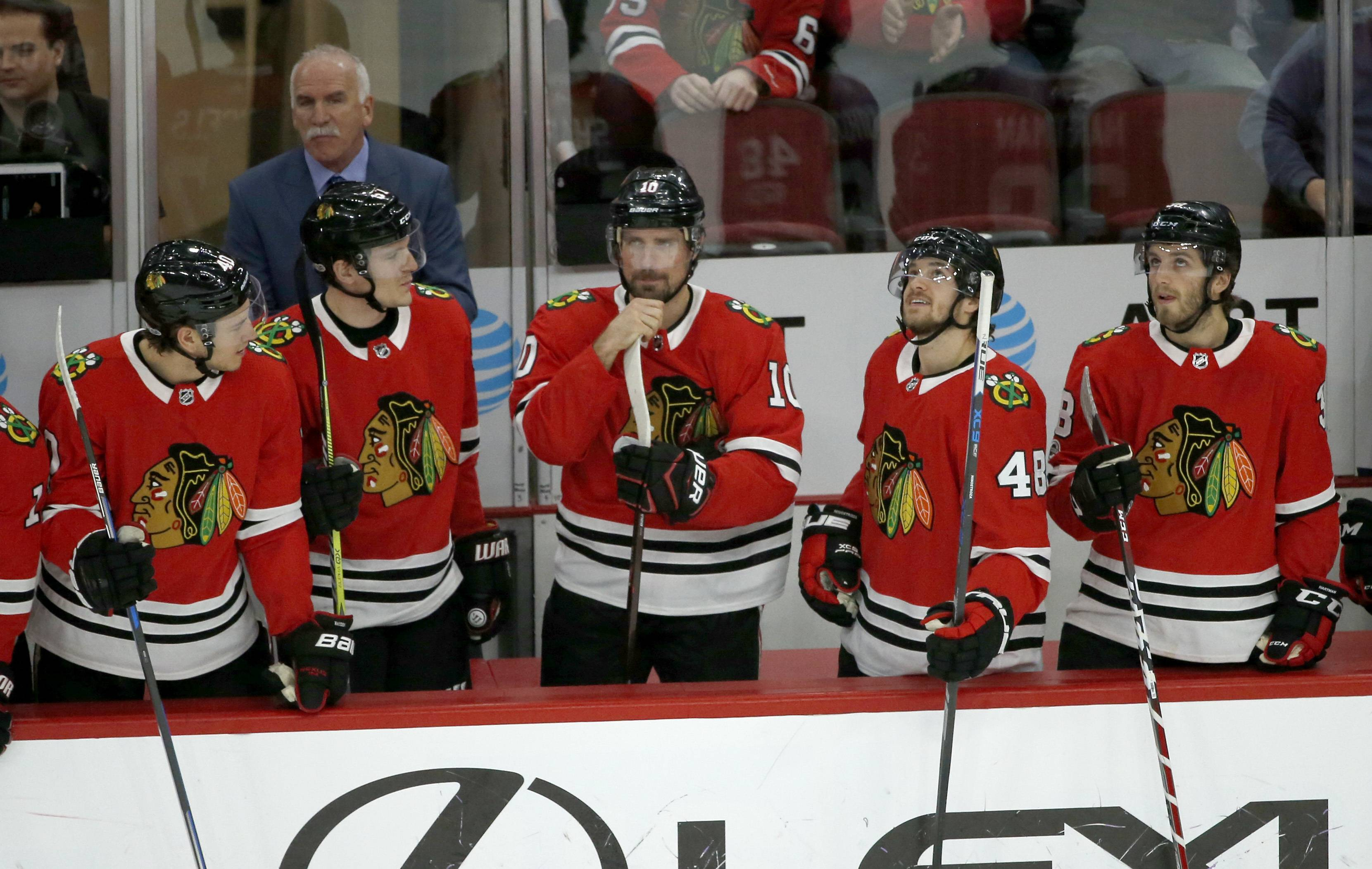 Chicago Blackhawks' Patrick Sharp, center, is acknowledged by teammates and fans for playing in his 900th career NHL hockey game during the first period against the Florida Panthers Tuesday, Dec. 12, 2017, in Chicago. (AP Photo/Charles Rex Arbogast)