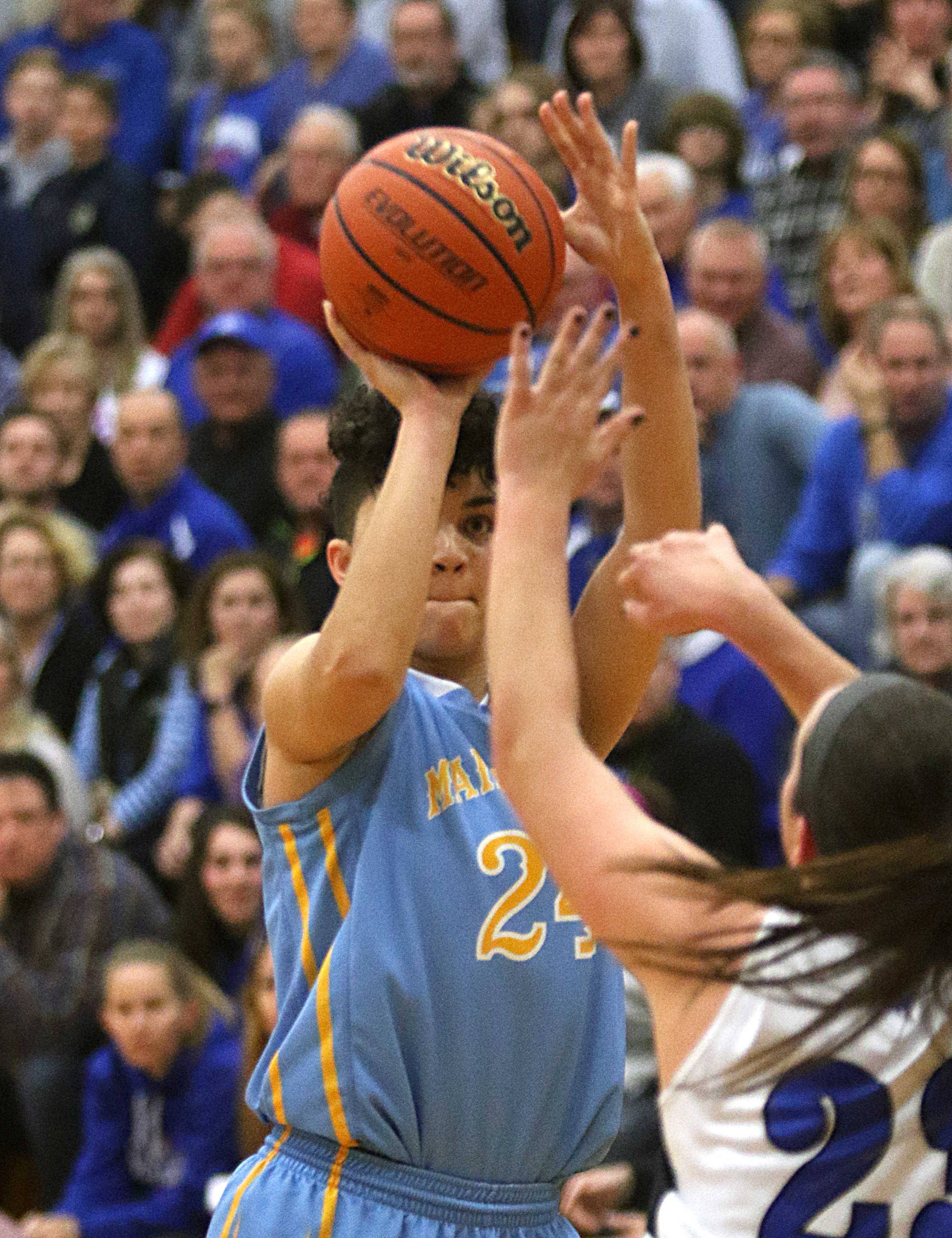 Maine West's Alisa Fallon lines up a jumper against Geneva during supersectional action at Addison Trail last season. She has committed to a future at West Point.