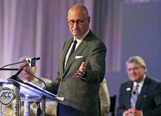 FILE - In this July 21, 2016 file photo, ESPN president John Skipper gestures as he talks about the new ACC/ESPN Network during a news conference at the Atlantic Coast Conference Football Kickoff in Charlotte, N.C. Skipper says he is resigning to take care of a substance abuse problem. The sports network says its former president, George Bodenheimer, will take over as acting head of the company for the next 90 days. (AP Photo/Chuck Burton, File)