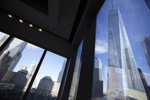 FILE - In this Aug. 15, 2016, file photo, window seating in the Eataly restaurant offers a view of One World Trade Center, right, in New York. Share prices were higher in Europe on Monday, Dec. 18, 2017, after a day of robust gains in Asia as investors anticipated passage of U.S. tax legislation that could boost corporate profits in the world's largest economy. (AP Photo/Mark Lennihan, File)