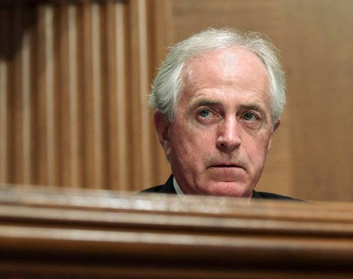 "In this Dec. 5, 2017 file photo, Sen. Bob Corker, R-Tenn., listens during a meeting of the Senate Banking Committee on Capitol Hill in Washington. The Senate Finance Committee chairman on Monday rejected as ""categorically false"" a report that Republican Sen. Bob Corker of Tennessee was responsible for a provision in the final tax bill that could help him financially. (AP Photo/Susan Walsh)"