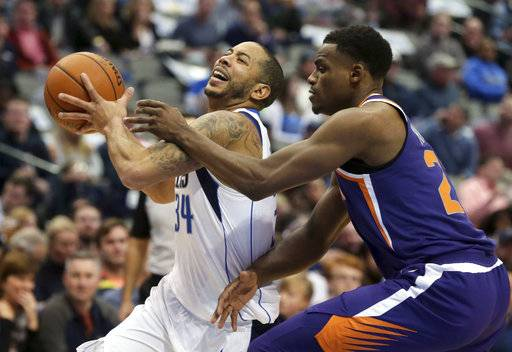 Dallas Mavericks guard Devin Harris (34) drives against Phoenix Suns forward Danuel House Jr. (23) during the first half of an NBA basketball game in Dallas, Monday, Dec. 18, 2017. (AP Photo/LM Otero)