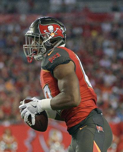 Tampa Bay Buccaneers tight end O.J. Howard catches a 30-yard pass for a touchdown against the Atlanta Falcons during the first half of an NFL football game, Monday, Dec. 18, 2017, in Tampa, Fla. (AP Photo/Phelan M. Ebenhack)