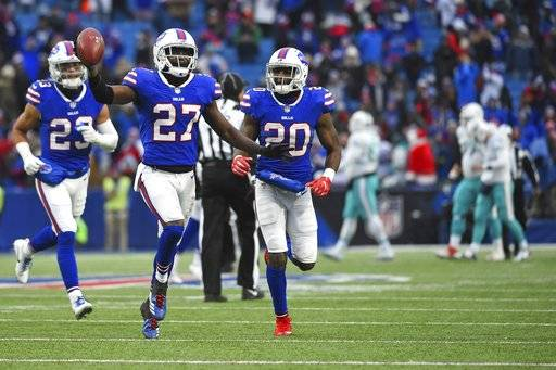 Buffalo Bills cornerback Tre'Davious White (27) celebrates with teammates Micah Hyde (23) and Shareece Wright (20) after intercepting a pass during the second half of an NFL football game against the Miami Dolphins, Sunday, Dec. 17, 2017, in Orchard Park, N.Y. The Bills won 24-16. (AP Photo/Rich Barnes)