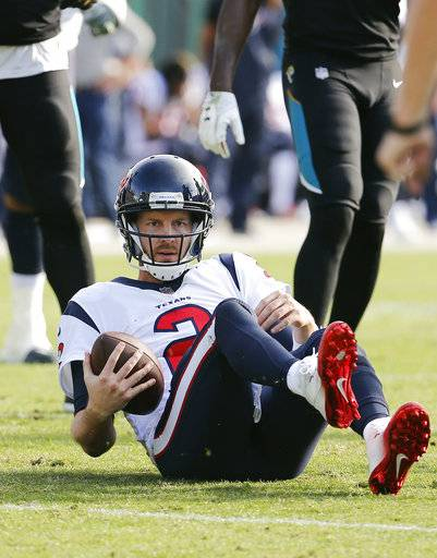 Houston Texans quarterback T.J. Yates gets up after being sacked by the Jacksonville Jaguars defense during the second half of an NFL football game, Sunday, Dec. 17, 2017, in Jacksonville, Fla. (AP Photo/Stephen B. Morton)