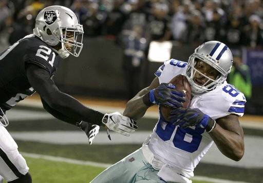 Dallas Cowboys wide receiver Dez Bryant (88) catches a pass against Oakland Raiders cornerback Sean Smith (21) during the second half of an NFL football game in Oakland, Calif., Sunday, Dec. 17, 2017. The Cowboys won 20-17. (AP Photo/Eric Risberg)