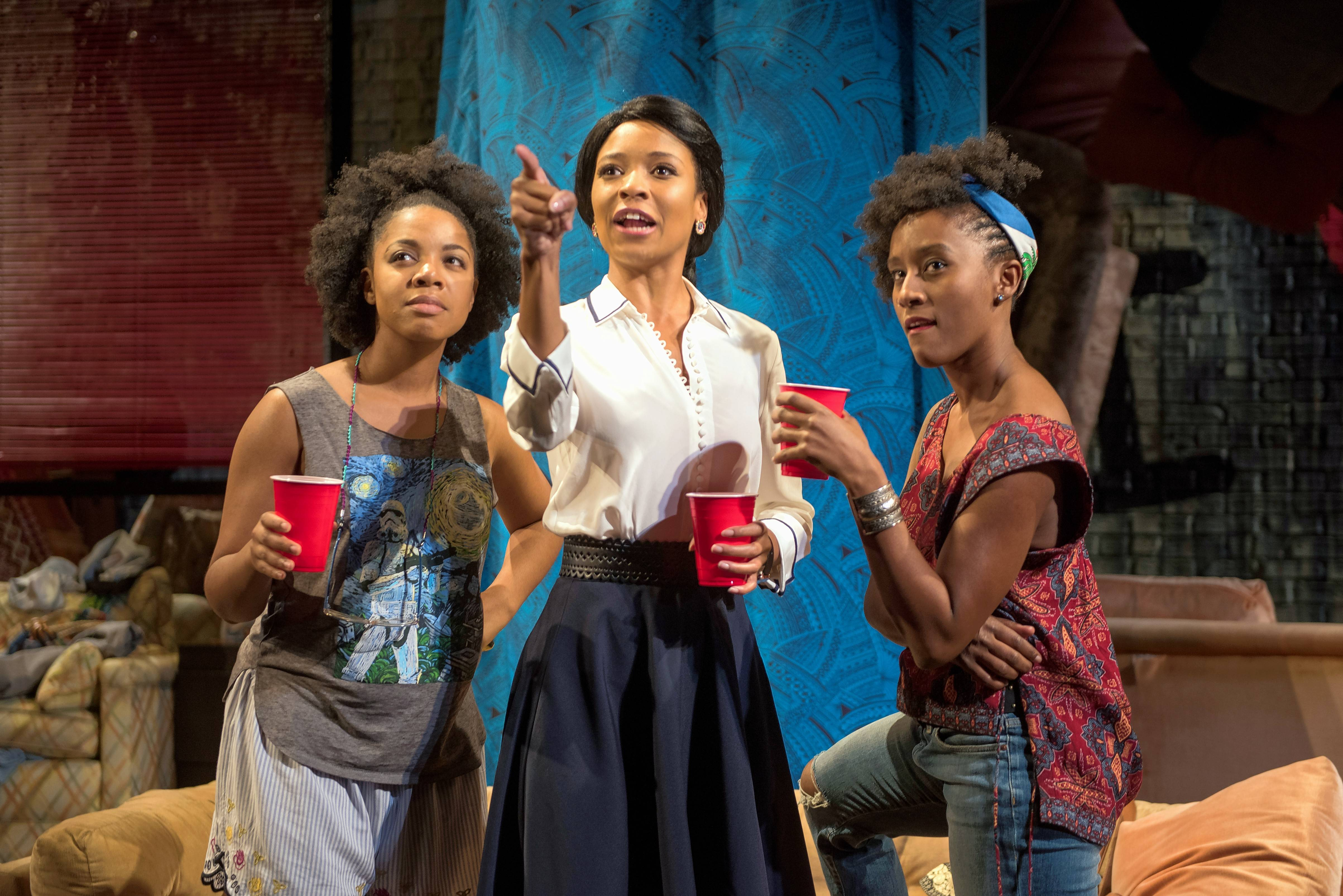 "Nora Carroll, left, Leea Ayers and Celeste M. Cooper star as young women negotiating friendship, intimacy and romance in Steppenwolf Theatre's premiere of ""BLKS"" by Aziza Barnes."