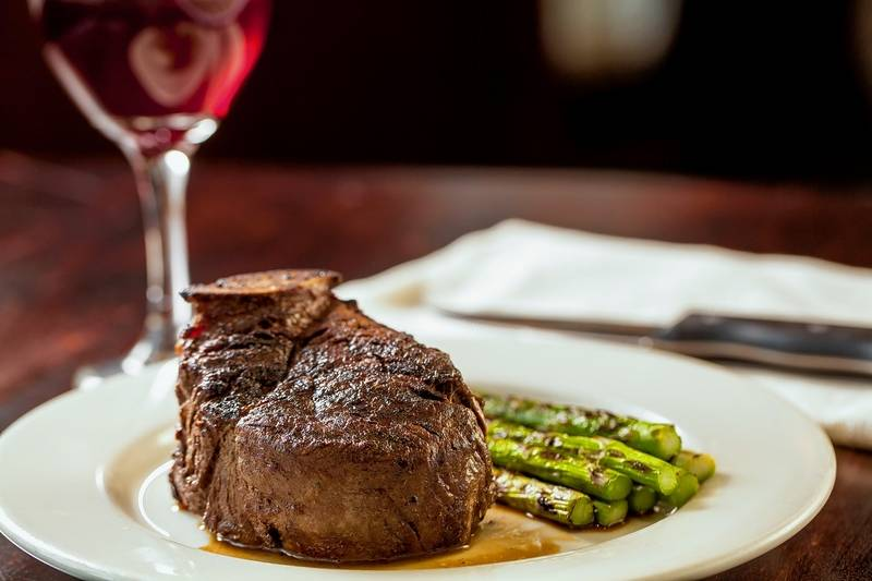 The filet from Wildfire on a plate with asparagus