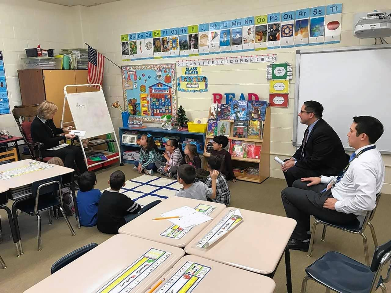 State Rep. Sam Yingling visits classrooms as a part of his principal for a day tour of Round Lake Village Elementary School.