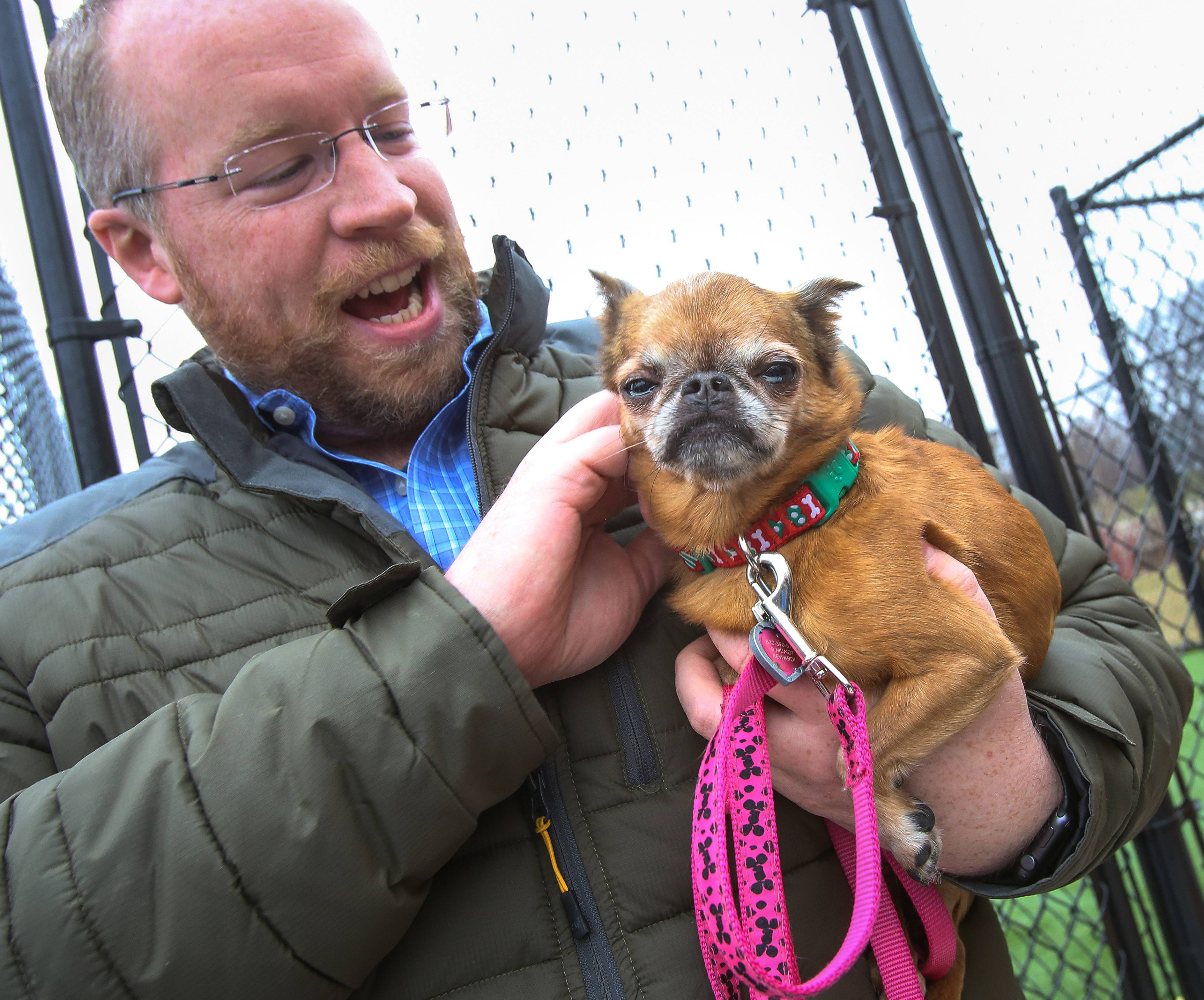 Bryan Mundt of Bolingbrook holds his rescue dog, Batty Boop, on Friday as he supports the introduction of a proposed state law that would require all pet stores in DuPage and Will counties to get their dogs, cats and rabbits from registered nonprofit animal controls, shelters or humane societies -- not from commercial breeders.