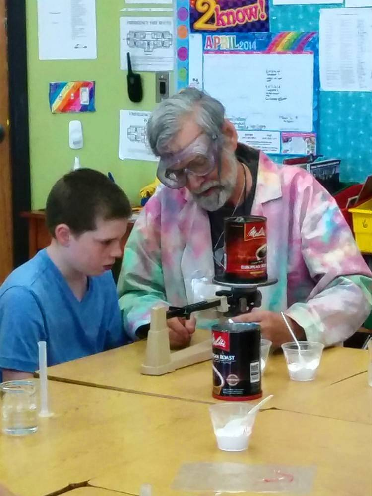 National Louis University Associate Professor Vito Dipinto teaches students at Prairie Crossing Charter School in Grayslake how to have fun with science.