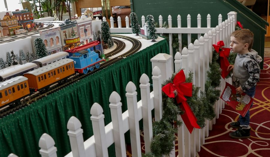 Elliott Bobbe, 2, is captivated by the holiday train layout. Elliott lives in Kansas and is at Sun City to visit his grandparents for the holidays.