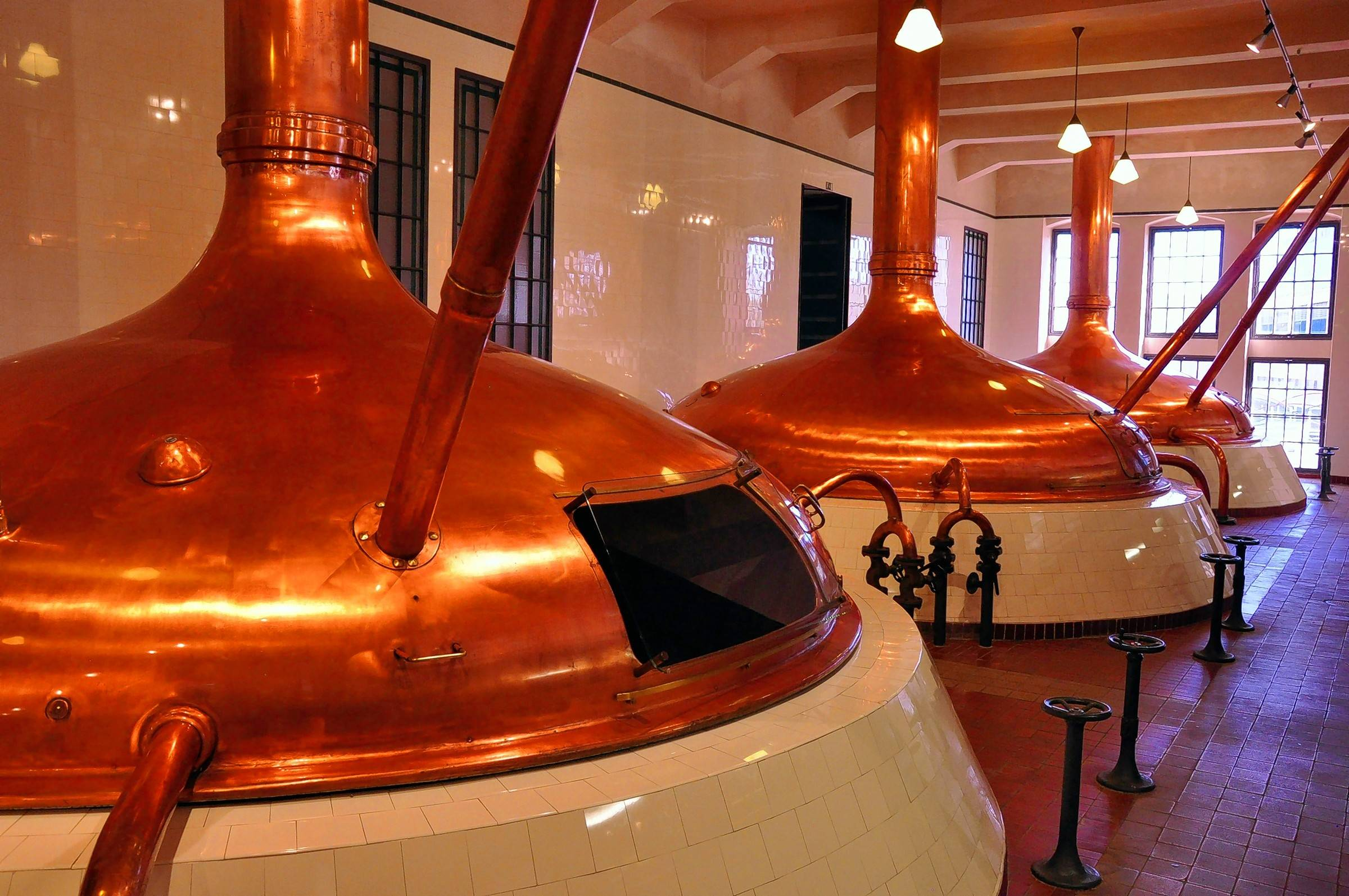 Copper brew kettles in the Pilsner Urquell Brewery are now just for show. More modern brew kettles are used today, but the recipe and ingredients go back to the 19th century.