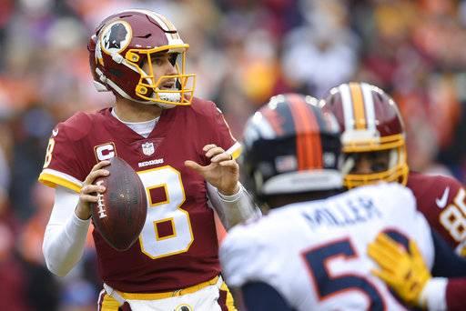 Washington Redskins Quarterback Kirk Cousins  Steps Back To Pass During The First Half
