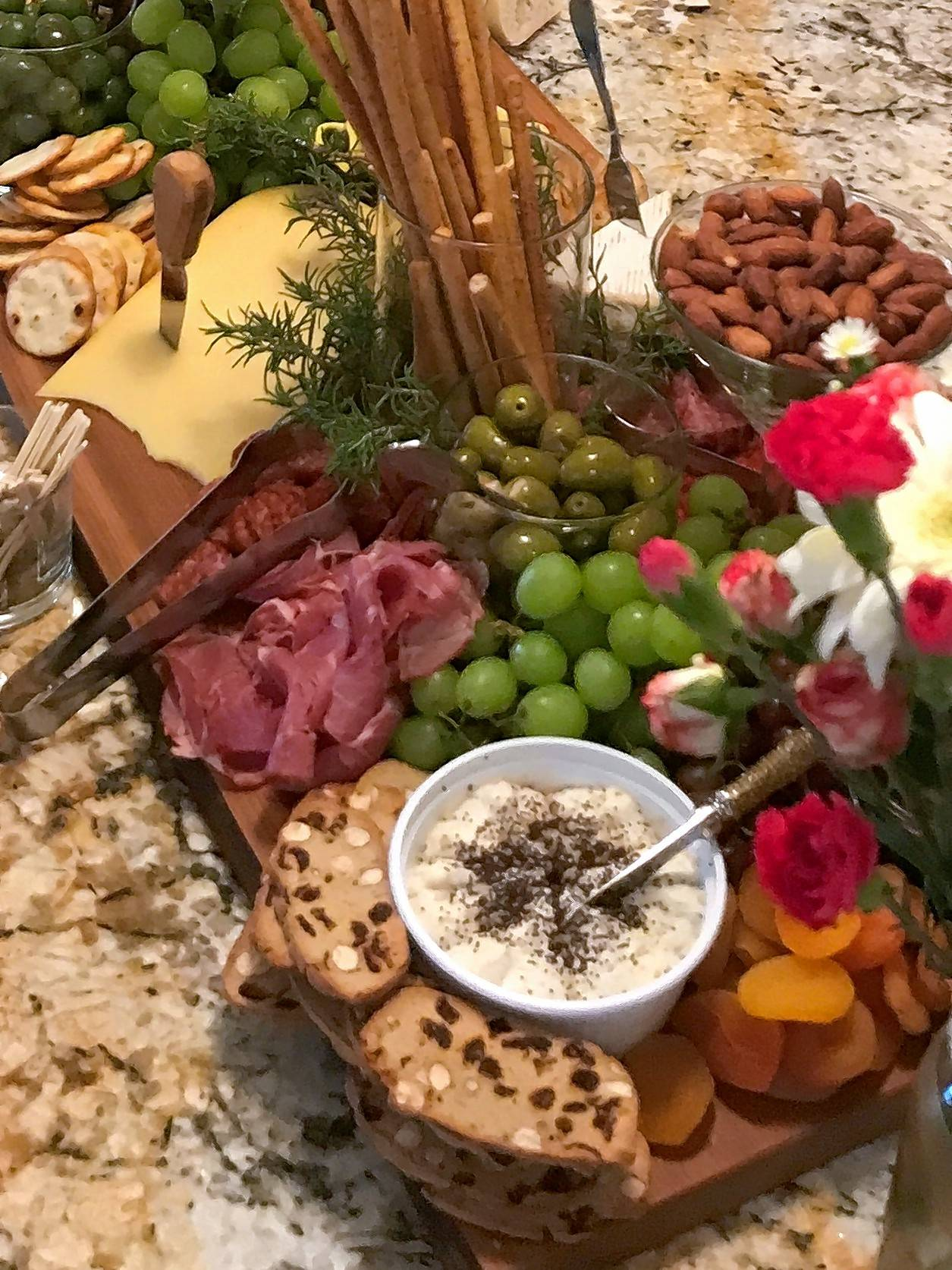 Placing fruit and nuts among the meat and cheese offerings makes for a tempting display.