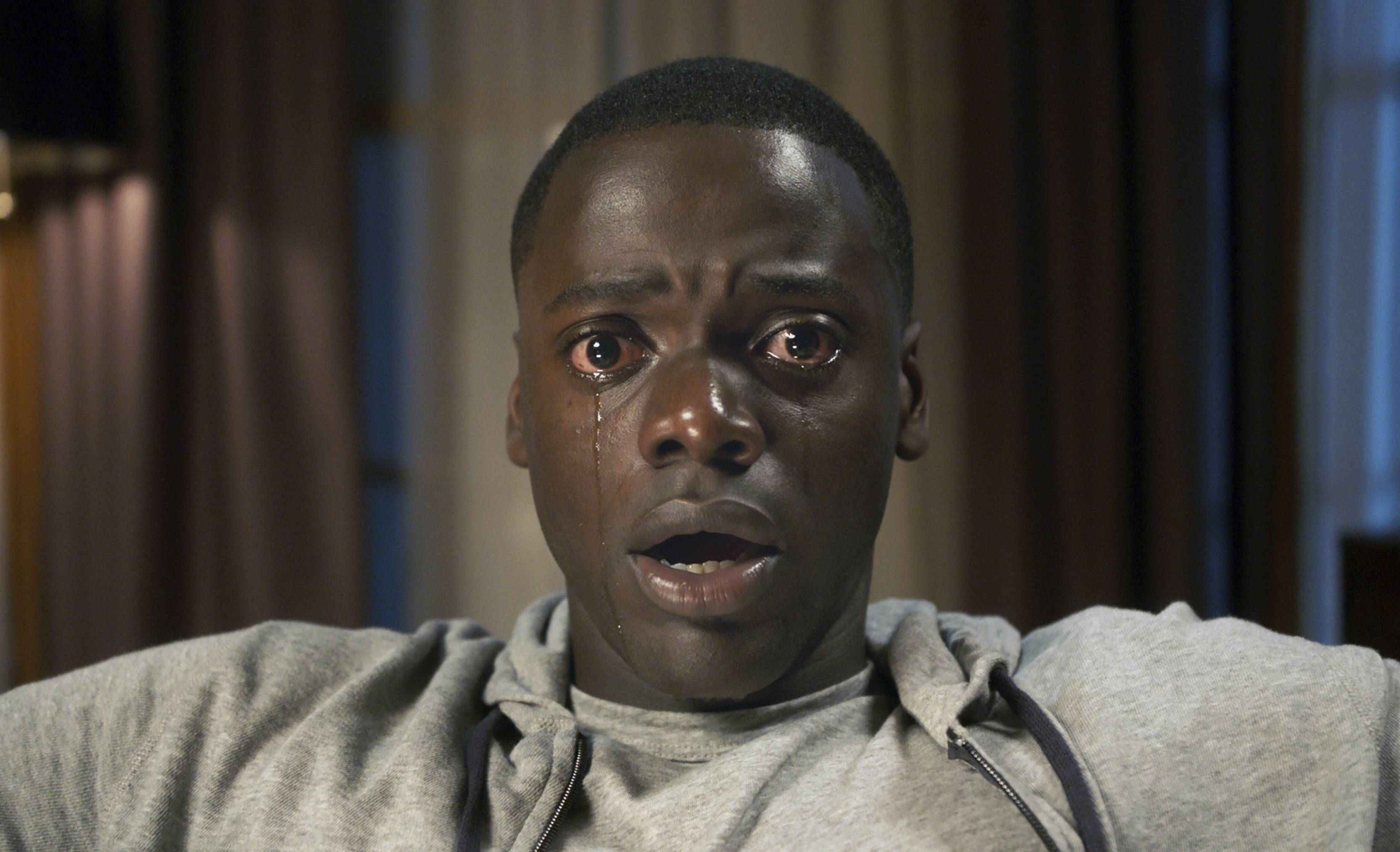 """Get Out,"" starring Daniel Kaluuya, tops Dann Gire's list of the top movies of 2017."