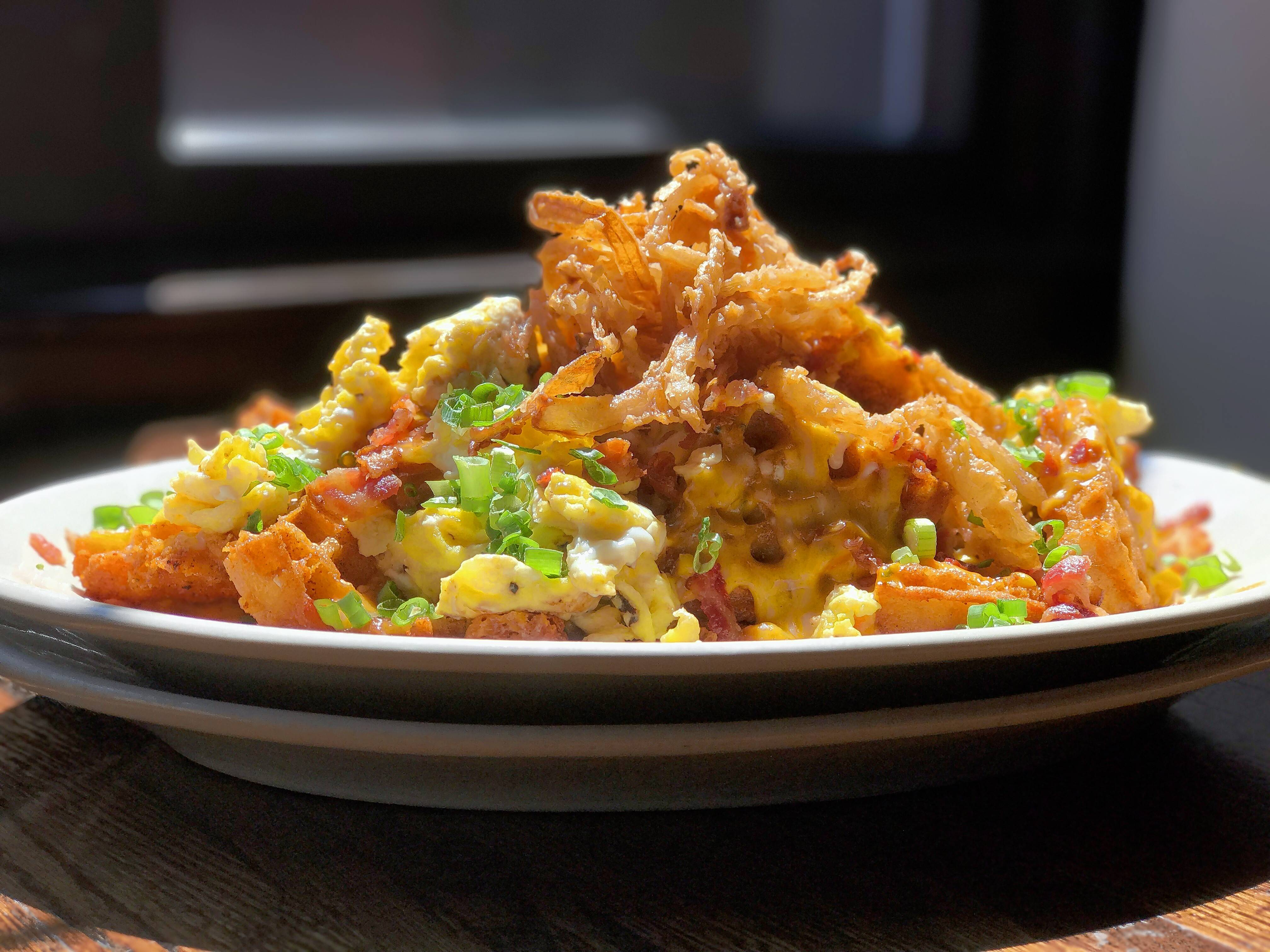Rack House will serve Waffle Breakfast Nachos (crispy waffle chips, bacon, scrambled eggs, scallions, cheese and crispy onions) during the Pajamas Brunch on New Year's Day.