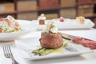 Perry's is offering the 8-ounce Filet Perry wrapped with Nueske's applewood-smoked bacon and topped with jumbo lump crab meat on New Year's Eve.