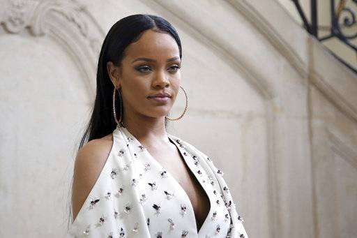 "FILE - In this Sept. 30, 2016, file photo, Singer Rihanna poses for photographers as she arrives to Christian Dior's Spring-Summer 2017 ready-to-wear fashion collection presented in Paris. Rihanna is mourning the death of her cousin and calling an end to gun violence. The singer posted three photos of herself with 21-year-old Tavon Kaiseen Alleyne on Instagram on Tuesday, Dec. 26, 2017, writing that she ""can't believe it was just last night that I held you in my arms!� Alleyne died Tuesday after being shot in Barbados, where Rihanna was born and raised."
