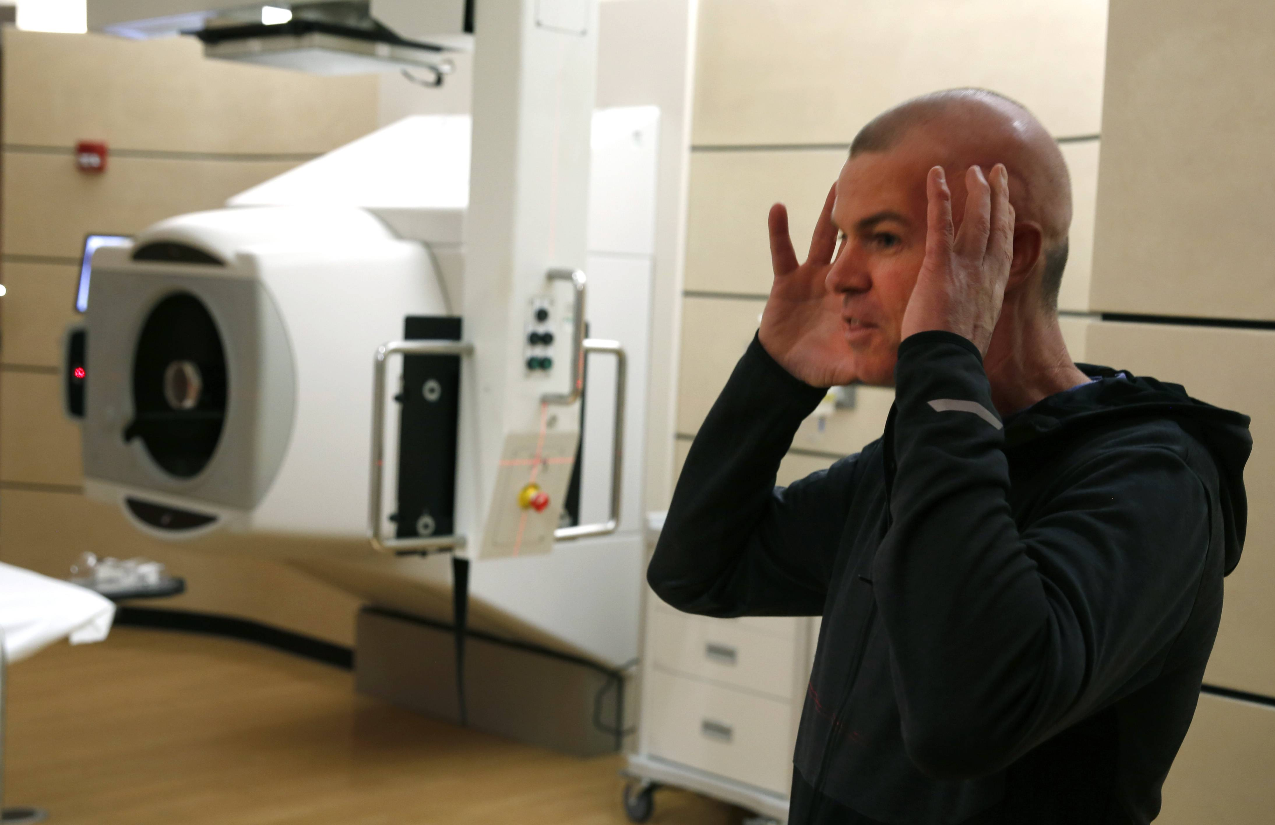 Dale Newman looks over his treatment room at the Northwestern Medicine Proton Center in Warrenville.